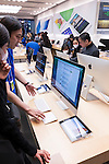 People at Apple store trying new technology. Ginza, Tokyo, Japan 2014