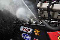 Oct 1, 2016; Mohnton, PA, USA; Raw fuel pours from the header exhaust pipes on the engine of the dragster of NHRA top fuel driver Shawn Reed during qualifying for the Dodge Nationals at Maple Grove Raceway. Mandatory Credit: Mark J. Rebilas-USA TODAY Sports