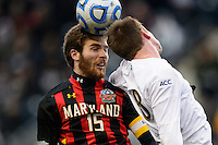 Maryland Terrapins forward Patrick Mullins (15) goes up for a header with Notre Dame Fighting Irish midfielder Nick Besler (8) during the first half of the championship match of the division 1 2013 NCAA  Men's Soccer College Cup at PPL Park in Chester, PA, on December 15, 2013.