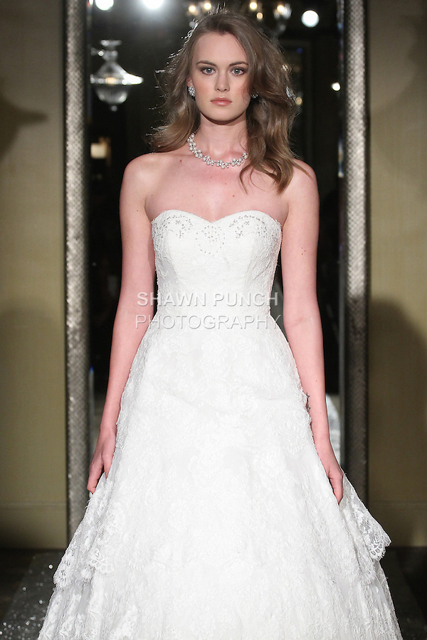 "Model walks runway in a bridal gown from the Oleg Cassini Weddings Autumn Winter 2015 ""Days of Magic"" collection, at Plaza Athenee, during New York Bridal Fashion Week, April 16, 2015."
