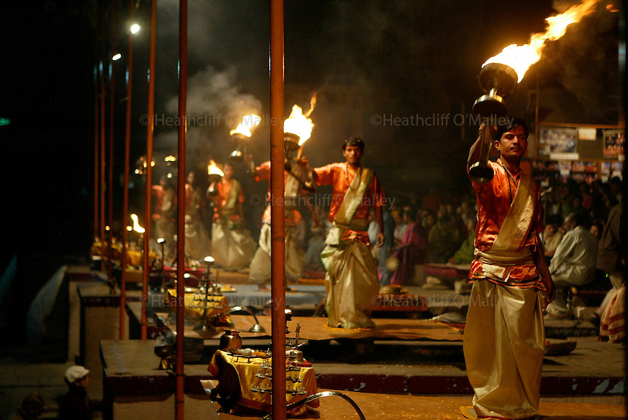 "Varanasi, India. Friday 16 March.The ""Ganga Aarti"" ceremony which takes place every evening at the Dasaswamedh Ghat in Varanasi, one of the holiest cities in India which is situated on the western bank of the Ganges River and attracts Hindu pilgrims from across the Globe who come to the Varanasi ghats (steps) to bathe in the waters of Ma Ganga..  Alongside the bathing ghats are also ""burning ghats"" where bodies are cremated in public, the ashes then given to the waters..     The Ganges river is 1557 miles long and stretches from the Himalayas to the Indian Port of Calcutta, supplying water to one twelth of the worlds population. ."