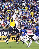 Cruzeiro goalkeeper Rafael and New England Revolution forward Zack Schilawski (15) compete for a high ball.  Brazil's Cruzeiro beat the New England Revolution, 3-0 in a friendly match at Gillette Stadium on June 13, 2010