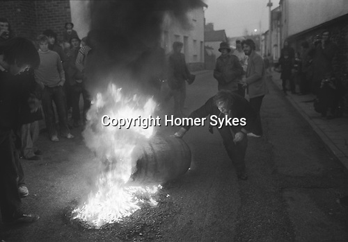 Tar Barrel Rolling, Ottery St Mary, Devon, England 1973. November 5th. Flaming tar barrels are run through the street of the village during the night.These are children  barrels.Adult barrels are larger andlater in the evening.