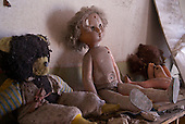 Dolls rest on a shelf inside a kindergarten in Pripyat, a ghost town left deserted by the nuclear disaster in the Chernobyl power station nearby. 30 years on, the city is still heavily contaminated, unfit for human life. <br /> <br /> The Chernobyl nuclear disaster happened on 26 April 1986.