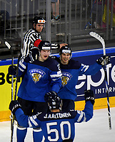 Joonas Kemppainen (L), who scored the 0:2 for Finland, celebrates with Antti Pihlstrom (R) and Juhamatti Aaltonen after the Ice Hockey World Championship quarter-final match between the US and Finland in the Lanxess Arena in Cologne, Germany, 18 May 2017. Photo: Monika Skolimowska/dpa /MediaPunch ***FOR USA ONLY***