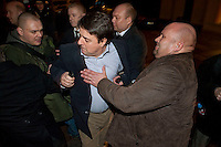 BNP leader Nick Griffin is stopped from attending a Q&A session at the Frontline Club in London by protesters from Unite Against Fascism. Griffins bodyguard Martin Reynolds (in brown coat) sprayed the protesters with some kind of indelible blue paint. He also sprayed Griffins hand (see picture in car).