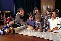 CLASS OF BAR MITZVAH STUDENTS WITH RABBI STUDYING TORAH IN SYNAGOGUE. BAR MITZVAH STUDENTS WITH TORAH IN SYNAGOGUE. SAN FRANCISCO CALIFORNIA.