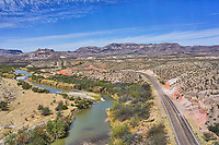 Another view of the Big Bend State Park as the Rio Grande flows through the desert and mountains along the river road as it follows the river in this landscape view.