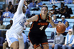 19 November 2014: Oklahoma State's Liz Donohoe (4) and North Carolina's Hillary Fuller (13). The University of North Carolina Tar Heels hosted the Oklahoma State University Cowgirls at Carmichael Arena in Chapel Hill, North Carolina in a 2014-15 NCAA Division I Women's Basketball game. UNC won the game 79-77.