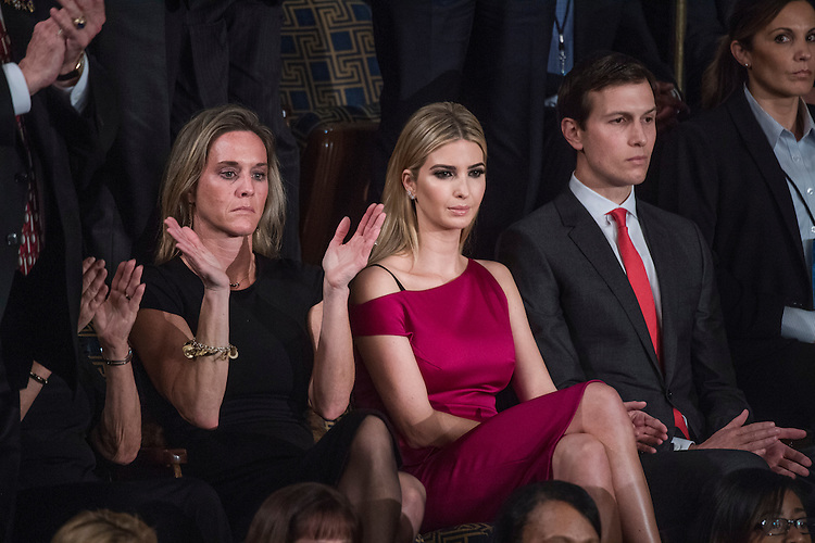 """UNITED STATES - FEBRUARY 28: Ivanka Trump, center, her husband Jared Kushner, and Carryn Owens, widow of Navy SEAL, William """"Ryan"""" Owens, listen to President Donald Trump address to a joint session of Congress in the Capitol's House Chamber, February 28, 2017. (Photo By Tom Williams/CQ Roll Call)"""