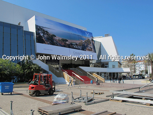 Workers preparing the area for the Cannes Film Festival, Palais des Festivals et des Congres, Cannes, France.
