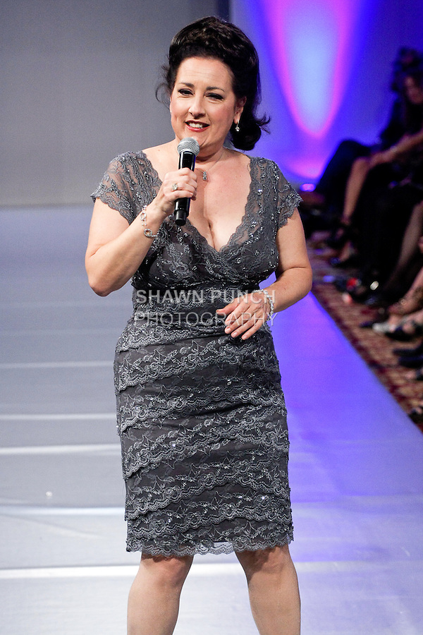 Soprano singer Cristina Fontanelli performs at the Andres Aquino fashion show, during Couture Fashion Week, in the Waldorf-Astoria Grand Ballroom September 17th 2011.