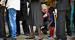 The Rev. Kirsten Fryer greets a young participant after a worship service of Nuer refugees from South Sudan who live in Cairo, Egypt. The service took place at St Andrews United Church of Cairo.