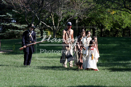 Native American Indians captured and escorted by army soldiers