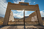 Ghost town of Rhyolite, Nevada<br /> <br /> Front fa&ccedil;ade of the HD &amp; LD Potter Store ruins, sun