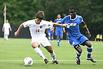 04 September 2011: NCSU's Danny DiPrima (14) pulls the jersey of UCSB's Fifi Baiden (GHA) (5). The University of California Santa Barbara Broncos defeated the North Carolina State University Wolfpack 1-0 at Koskinen Stadium in Durham, North Carolina in an NCAA Division I Men's Soccer game.