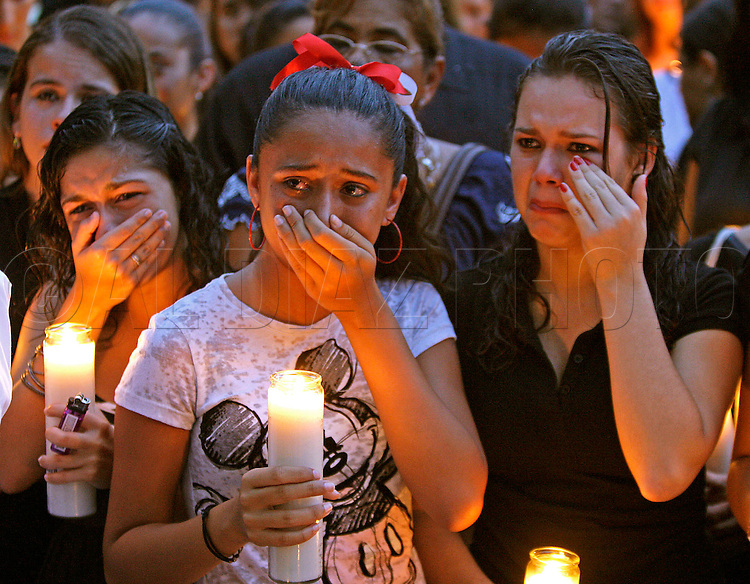 Students, family and friends held a candle light vigil for Coral Gables High School stabbing victim Juan Carlos Rivera.on September 18, 2009.