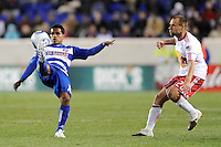 David Ferreira (10) of FC Dallas plays the ball as Joel Lindpere (20) of the New York Red Bulls watches. The New York Red Bulls defeated FC Dallas 2-1 during a Major League Soccer (MLS) match at Red Bull Arena in Harrison, NJ, on April 17, 2010.