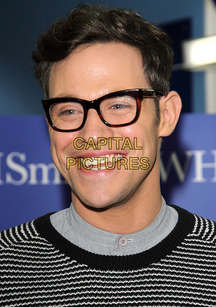 Will Young.attends a book signing for his book 'Funny Peculiar' at WH Smith, Milton Keynes, Buckinghamshire, England..2nd November 2012.headshot portrait glasses black white stripe top smiling .CAP/JIL.©Jill Mayhew/Capital Pictures.
