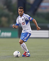 Montreal Impact defender Dennis Iapichino (17) dribbles. In a Major League Soccer (MLS) match, Montreal Impact defeated the New England Revolution, 1-0, at Gillette Stadium on August 12, 2012.