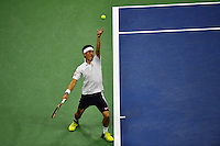 NEW YORK, USA - SEPT 10, Kei Nishikori of Japan serves to Stan Wawrinka of Switzerland during their Men's Singles Semifinal Match of the 2016 US Open at the USTA Billie Jean King National Tennis Center on September 9, 2016 in New York.  photo by VIEWpress