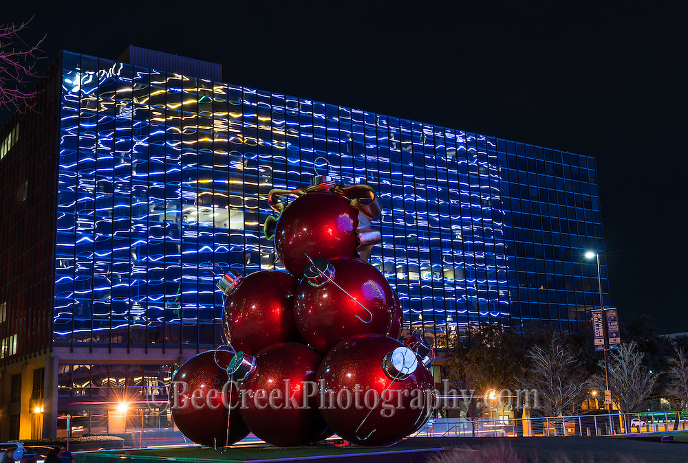 We loved these oversize Christmas ornament on the lawn at the Omni Hotel we capture several images from here but noted that looking across the street from there the colors reflected back from the Omni constantly changing light show on the side of the buildings giving it an abstract look.
