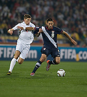 The USA's Clint Dempsey dribbles past England's Steven Gerrard (4) in the first half of the 2010 World Cup match between USA and England in Rustenberg, South Africa on Saturday, June 12, 2010.
