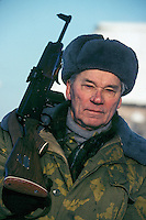 Izhevsk, Siberia, Russia, 10/11/1993.<br /> Weapons inventor Mikhail Kalashnikov carrying a hunting rifle of his own design on a hunting trip for deer, moose and elk on his birthday.