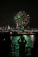 New York, USA. 28 June 2014. People take pictures of the empire state while fire works are seen during the gay pride parade 2014 in New York. Photo by Eduardo MunozAlvarez/VIEWpress