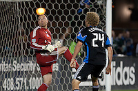 Steven Lenhart (right) and Matt Reis (left) watches the ball on the goal. The San Jose Earthquakes defeated the New England Revolution 2-1 at Buck Shaw Stadium in Santa Clara, California on May 21st, 2011.
