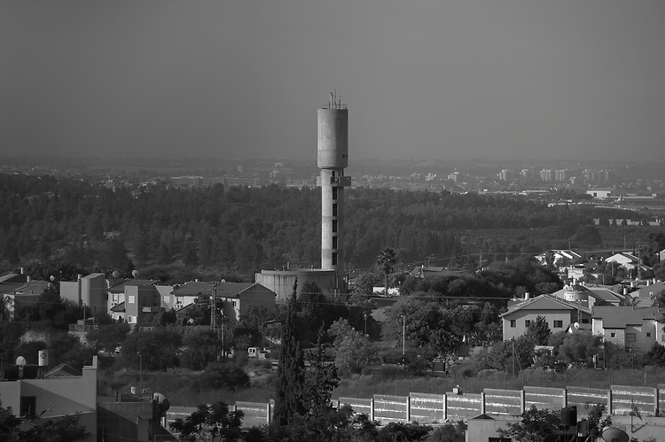 Seen from a mosque minaret in Hableh, a water tower stands above Matan.
