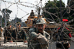Egyptian military soldiers reinforce the barbed wire barricade outside the Orouba Presidential Palace February 11, 2011 in the Heliopolis district of Cairo, Egypt. Protesters marched Friday on a number of public buildings including the palace in an effort to spread their ongoing protests that are now in their 18th day. .(Photo by Scott Nelson)
