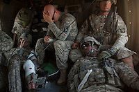Four US Army soldiers from the 101st Airborne are treated on board a medevac helicopter from Charlie Company, Sixth Battalion, 101st Aviation Regiment near Kandahar, after their convey was ambushed with RPG and IEDs (improvised explosive devices).