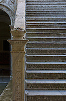 """One of the historically rich staircases in Venice, a city in northeast Italy which is renowned for the beauty of its setting, its architecture and its artworks. It is the capital of the Veneto region. In 2009, there were 270,098 people residing in Venice's comune (the population estimate of 272,000 inhabitants includes the population of the whole Comune of Venezia; around 60,000 in the historic city of Venice (Centro storico); 176,000 in Terraferma (the Mainland), mostly in the large frazioni of Mestre and Marghera; 31,000 live on other islands in the lagoon). Together with Padua and Treviso, the city is included in the Padua-Treviso-Venice Metropolitan Area (PATREVE) (population 1,600,000)...The name is derived from the ancient Veneti people who inhabited the region by the 10th century B.C. The city historically was the capital of the Venetian Republic. Venice has been known as the """"La Dominante"""", """"Serenissima"""", """"Queen of the Adriatic"""", """"City of Water"""", """"City of Masks"""", """"City of Bridges"""", """"The Floating City"""", and """"City of Canals"""". Luigi Barzini described it in The New York Times as """"undoubtedly the most beautiful city built by man"""". Venice has also been described by the Times Online as being one of Europe's most romantic cities...The city stretches across 117 small islands in the marshy Venetian Lagoon along the Adriatic Sea in northeast Italy. The saltwater lagoon stretches along the shoreline between the mouths of the Po (south) and the Piave (north) Rivers...The Republic of Venice was a major maritime power during the Middle Ages and Renaissance, and a staging area for the Crusades and the Battle of Lepanto, as well as a very important center of commerce (especially silk, grain, and spice) and art in the 13th century up to the end of the 17th century. This made Venice a wealthy city throughout most of its history. It is also known for its several important artistic movements, especially the Renaissance period. Venice has played an important role in the history o"""
