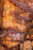 711053035 indian petroglyphs or rock art carved into reddish-colored rocks in little petroglyph canyon on the china lake naval air station near ridgecrest california