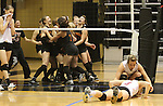 CHAD PILSTER &bull; Hays Daily News<br /> <br /> Hoxie's Gabriel Spresser (2) checks on Terran Hoyt (3) as she remains on the floor after missing a dive stop the game winning point on Saturday, November 2, 2013, during the finals of the Class 1A-Division 1 volleyball State Tournament at Fort Hays State University's Gross Memorial Coliseum in Hays, Kansas. Hoxie was beat by Centralia. This is the 43rd Annual Kansas State High School Activities Association State Tournament.