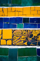 View of a hand painted tile on Selaron's Stairs (Escadaria Selarón), a colorful mosaic tile stairway, in Rio de Janeiro, Brazil, 12 February 2012. World-famous staircase, mostly covered by vibrant yellow, green and blue tiles (inspired by the colors of the Brazilian flag), is the masterpiece of Chilean-born artist Jorge Selarón who considers it as a personal tribute to the Brazilian people. Connecting the neighborhoods of Santa Teresa and Lapa, the stairway is made up of 250 steps and measures 125 meters long. In 1990 Selarón began work on the stairway, creating a constantly evolving piece of art, now adorned with over 2,000 brightly colored tiles collected from over 60 countries. Selarón funds his one man's project through donations and the sale of his black-and-red paintings which mostly depict a pregnant African woman or himself. Living his passion, the eccentric 65-year-old artist claims that this crazy and unique dream will only end on the day of my death.