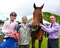 Winner of The Smith & Williamson Maiden Fillies' Stakes (Div1), Fleur Forsyte ridden by Daniel Muscott and trained by James Fanshawe with stable staff in the winners enclosure during Afternoon Racing at Salisbury Racecourse on 18th May 2017