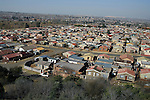 SOWETO, SOUTH AFRICA AUGUST 11: An overview of traditional small houses on August 11, 2006 in Soweto, Johannesburg, South Africa. Most people live in these types of houses. Soweto is South Africa?s largest township and it was founded about one hundred years to make housing available for black people south west of downtown Johannesburg. The estimated population is between 2-3 million. Many key events during the Apartheid struggle unfolded here, and the most known is the student uprisings in June 1976, where thousands of students took to the streets to protest after being forced to study the Afrikaans language at school. Soweto today is a mix of old housing and newly constructed townhouses. A new hungry black middle-class is growing steadily. Many residents work in Johannesburg but the last years many shopping malls have been built, and people are starting to spend their money in Soweto. .(Photo by Per-Anders Pettersson/Getty Images)...