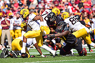 College Park, MD - OCT 15, 2016: Minnesota Golden Gophers running back Rodney Smith (1) breaks free of a tackle by Maryland Terrapins defensive lineman Kingsley Opara (57) during game between Maryland and Minnesota at Capital One Field at Maryland Stadium in College Park, MD. (Photo by Phil Peters/Media Images International)