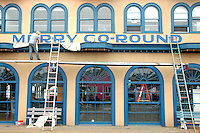 Visual Artist Richard Ankrom paints Merry Go-Round on the Santa Monica Pier carousel building  the on Tuesday, October 18, 2011. http://ankrom.org/