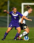 31 August 2007: University of Central Arkansas Sugar Bears' Brittney Warren (7), a Freshman from Cedar Park, Texas, battles Alison Hemphill (15), a Freshman from Morrisville, VT, during game action against the University of Vermont Catamounts at Historic Centennial Field in Burlington, Vermont. The Catamounts defeated the Sugar Bears 1-0 during the TD Banknorth Soccer Classic...Mandatory Photo Credit: Ed Wolfstein Photo