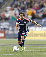 New England Revolution midfielder Lee Nguyen (24) brings the ball forward.  In a Major League Soccer (MLS) match, the New England Revolution (blue) defeated D.C. United (white), 2-1, at Gillette Stadium on September 21, 2013.