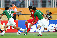 Ali Dael of Iran trys to pull up between Gonzalo Pineda and Ricardo Osorio of Mexico. Mexico defeated Iran 3-1 during a World Cup Group D match at Franken-Stadion, Nuremberg, Germany on Sunday June 11, 2006.