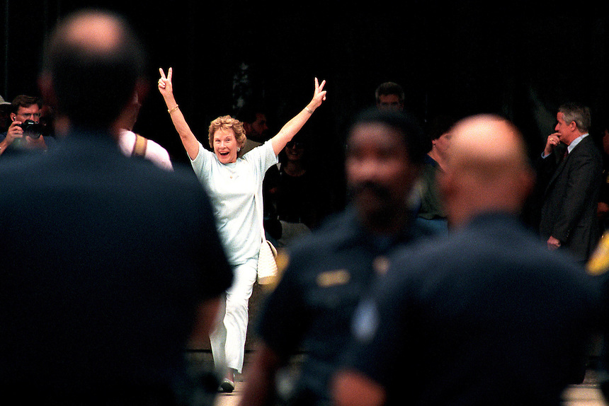 Victory signs held high, Peggy Broxterman leaves Federal Court in Denver after a jury convicted Timothy McVeigh in the 1995 bombing of the Murrah Federal Building in Oklahoma City. Broxterman's son was killed in the blast.