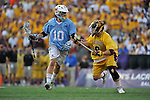 29 MAY 2011:  Kevin McCormick (28) of Tufts University moves the ball against Andrew Sellers (8) of Salisbury University during the Division III Men's Lacrosse Championship held at M+T Bank Stadium in Baltimore, MD.  Salisbury defeated Tufts 19-7 for the national title. Larry French/NCAA Photos