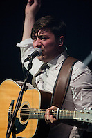 "Marcus Mumford plays guitar and sings during the hit ""Little Lion Man,"" from Mumford & Sons' debut album Sigh No More at the Susquehanna Bank Center on February 16, 2013."