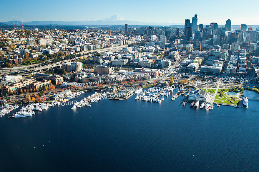 Aerial view of Seattle's Museum of History and Industry, Lake Union Park, and South Lake Union neighborhood with downtown skyline and Mount Rainier in the background