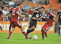Dwayne De Rosario (7) of D.C. United goes against Austin Berry (22) left and Arevalo Rios (5) right of the Chicago Fire.  The Chicago Fire defeated D.C. Untied 3-0, at RFK Stadium, Friday October 4 , 2013.