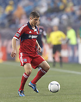 Chicago Fire midfielder Logan Pause (12) controls the ball. In a Major League Soccer (MLS) match, the New England Revolution defeated Chicago Fire, 2-0, at Gillette Stadium on June 2, 2012.